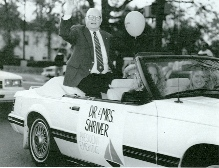 Dr. Shriver waving in Homecoming Parade
