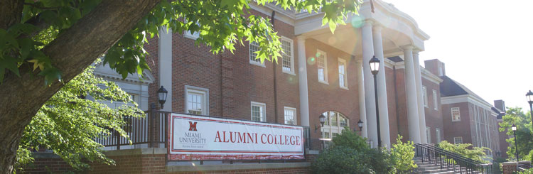 Alumni College sign in front of engineering building